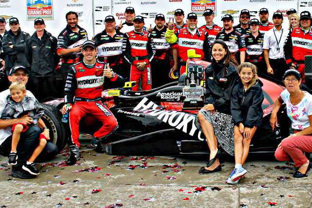 Sebastien celebrates in victory circle with his team and family after an INDYCAR win in Detroit